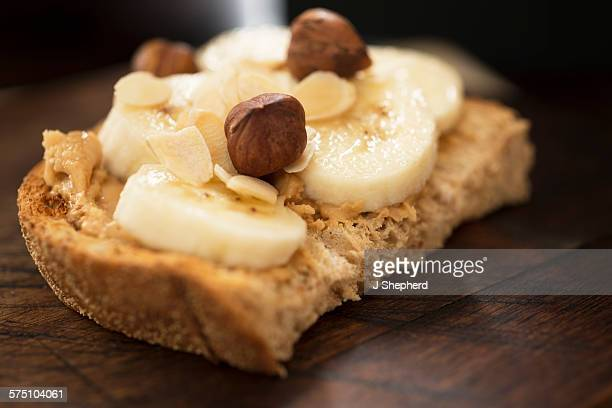 Peanut butter, banana and nuts on toast