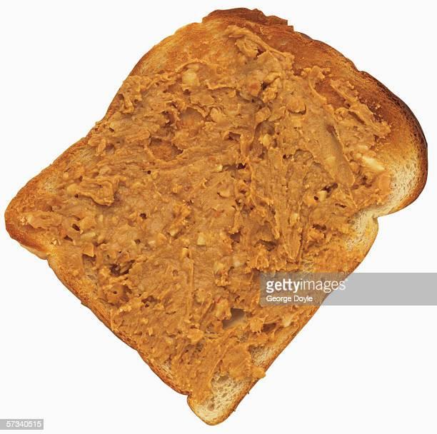 peanut butter on slice of bread