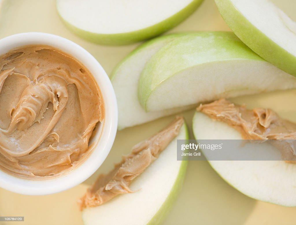 Peanut butter on sliced apple : Stock Photo