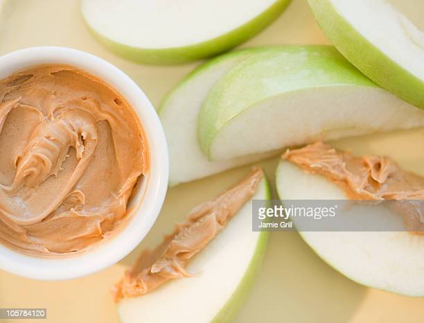 Peanut butter on sliced apple