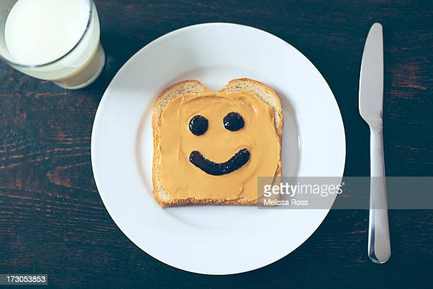 Peanut butter sandwich with jelly happy face.