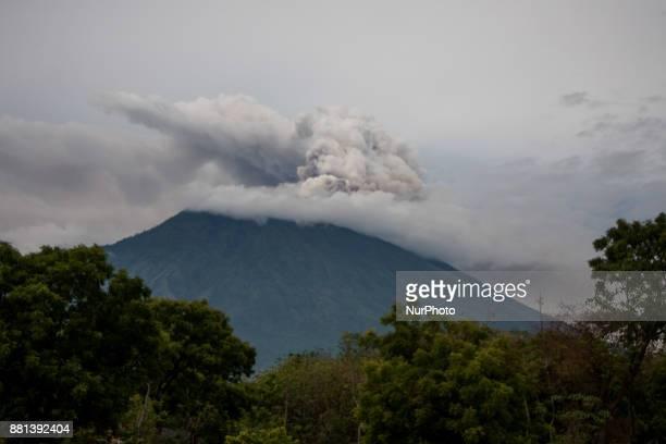 Peanut farmers planted seeds during the eruption of Mount Agung took place on 29 November 2017 in Karangasem regency Bali Indonesia Ngurah Rai...