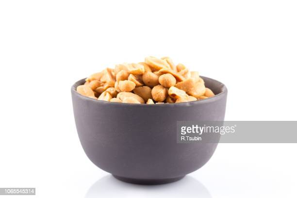 peanut nuts salt in bowl isolated on white background - bowl stock pictures, royalty-free photos & images