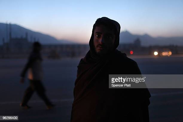 A peanut seller pauses along a road at dusk January 31 2010 in Kabul Afghanistan Despite years of foreign involvement and the money being committed...