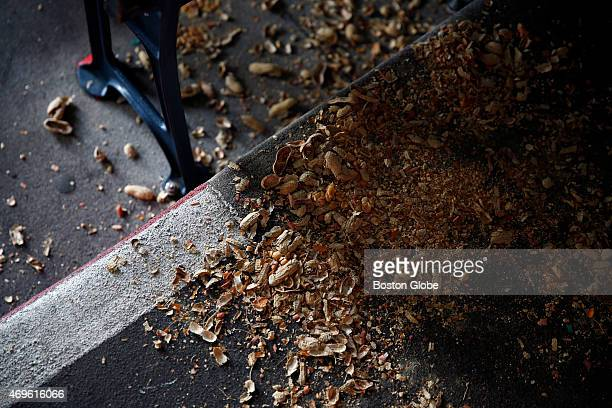 Peanut shells litter the ground during the Red Sox home opener at Fenway Park in Boston on April 13 2015