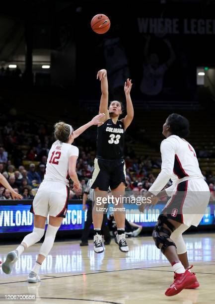 Peanut Tuitele of the Colorado Buffaloes shoots over the defense of Lexie Hull of the Stanford Cardinal during the third quarter of a game between...