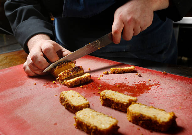 Peanut-crusted tempeh, marinated in lime pickle made by Adam Flood at Grace. Adam slices the tempeh after is has been seared.