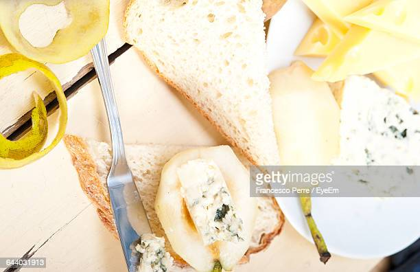 pear and cheese with bread on table - roquefort cheese stock photos and pictures