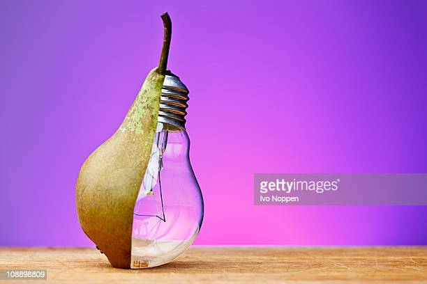 pear and light bulb - half full stock photos and pictures