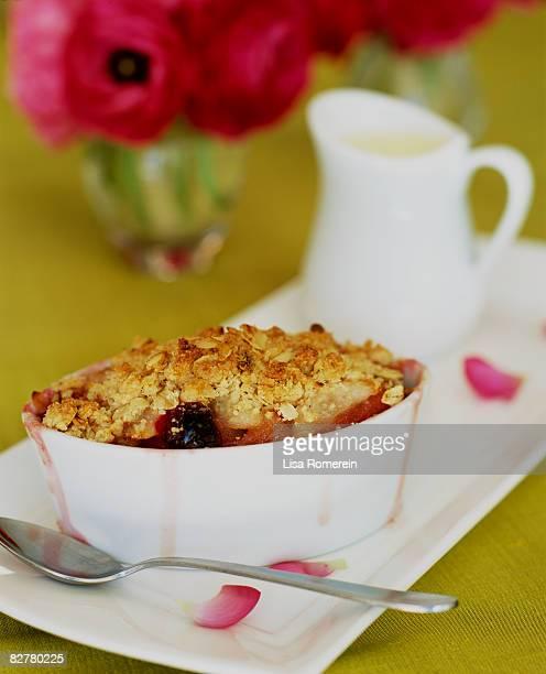 Pear cranberry crisp dessert with cream