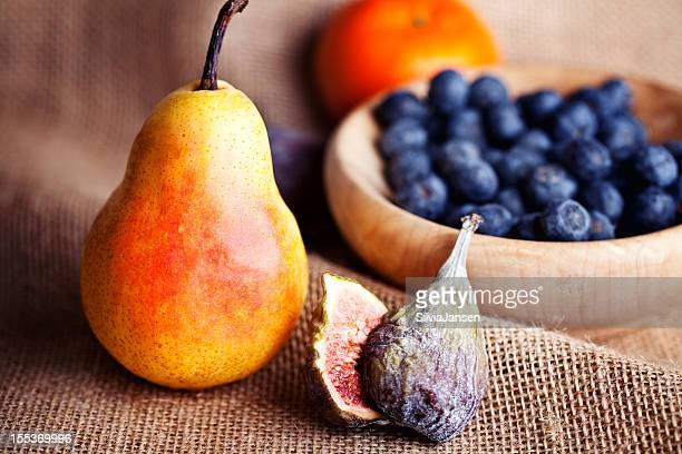 pear, fig and a bowl with blue berries