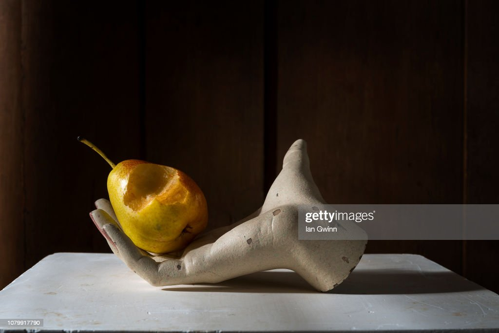 Pear in Mannequin Hand_1 : Stock Photo
