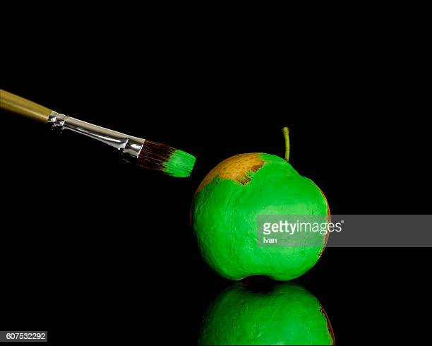 A Pear is painted to Green Apple