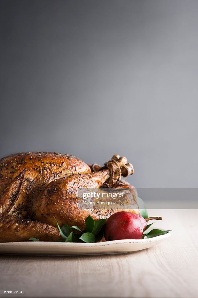 Pear on plate with cajun turkey : Stock Photo