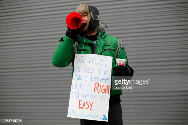 Pearce Dowden a a sixth grade math teacher with the Acero charter school network poses for a portrait as he yells through a megaphone during a strike...