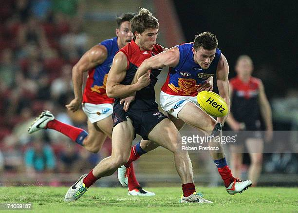 Pearce Hanley of the Lions contests the ball during the round 17 AFL match between the Melbourne Demons and the Brisbane Lions at TIO Stadium on July...