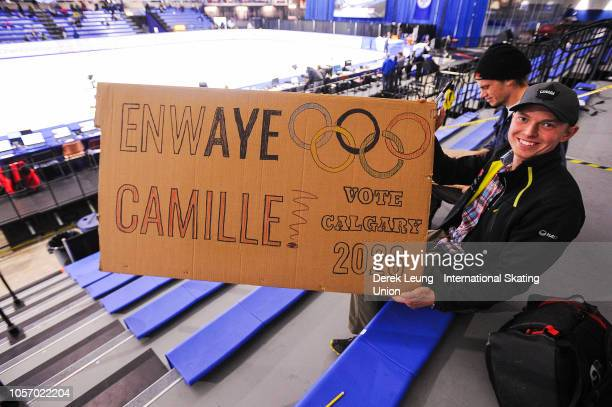Pearce Hanna of Canmore Alberta holds up a sign encouraging Calgary's 2026 Olympic bid during the ISU World Cup Short Track Calgary at the Olympic...