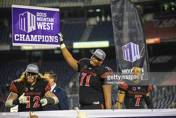 Pearce Slater of the San Diego State Aztecs holds a champions sign after winning the Mountain West Championship game against the Air Force Falcons at...