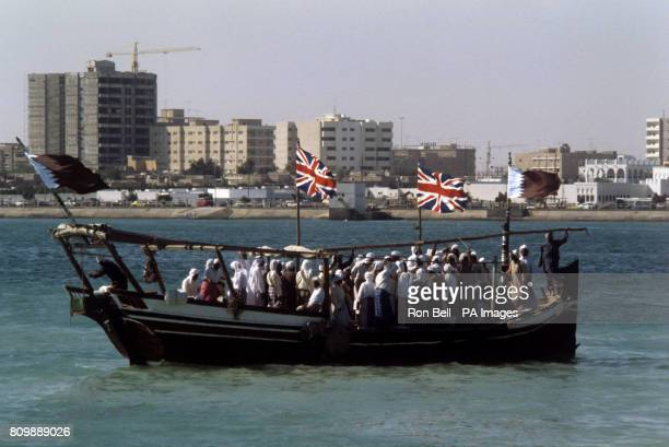 Pearl divers aboard dhows welcome the arrival of Queen Elizabeth II at Doha Port Qatar