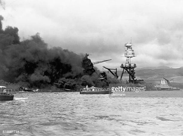Pearl Harbor, HI: Japanese surprise aerial attack on Pearl Harbor, December 7 the onset of the war with Japan. Photograph of USS Arizona at height of...