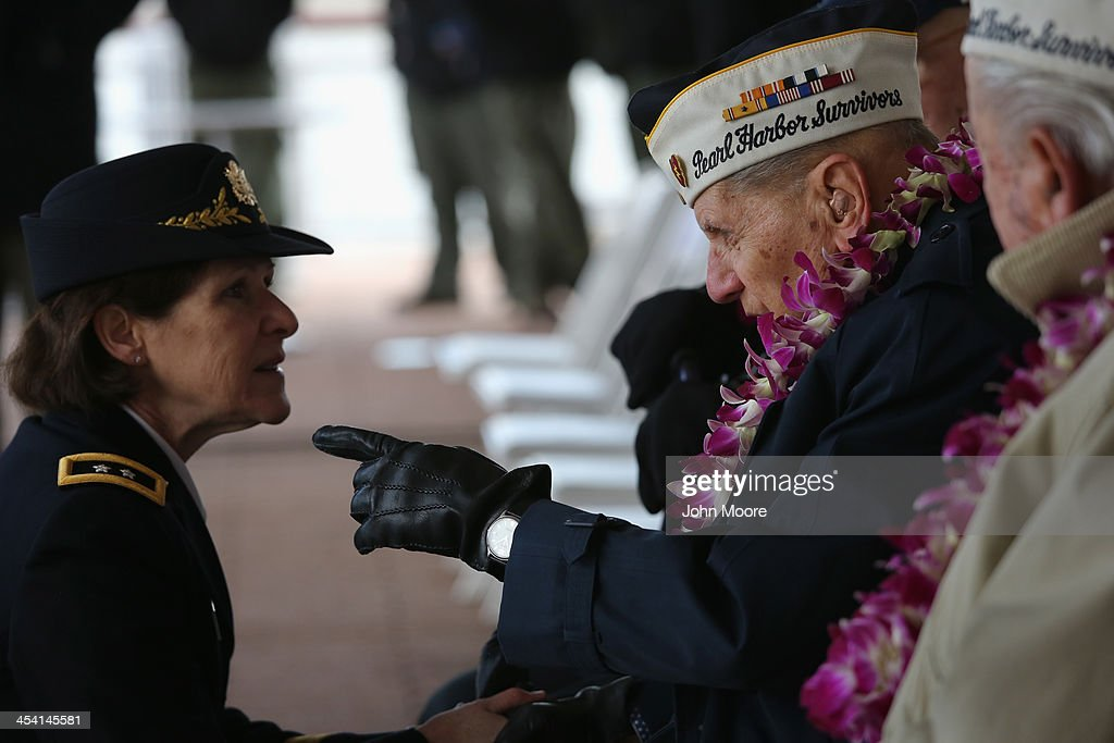 Pearl Harbor survivor Aaron Chavin, 90, speaks with U.S. Army Major General Margaret Boor at a ceremony marking the 72nd anniversary of the attack on Pearl Harbor, Hawaii on December 7, 2013 in New York City. Four Pearl Harbor survivors from the New York area gathered with former crew members of the USS Intrepid to mark the Japanese surprise attack on December 7, 1941 which killed 2,402 Americans and brought the United States into WWII.