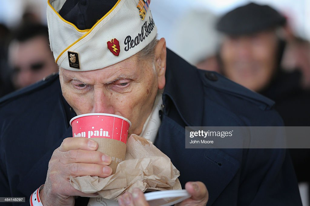 Pearl Harbor survivor Aaron Chavin, 90, warms up with a cup of coffee at a ceremony marking the 72nd anniversary of the attack on Pearl Harbor, Hawaii on December 7, 2013 in New York City. Four Pearl Harbor survivors from the New York area gathered with former crew members of the USS Intrepid to mark the Japanese surprise attack on December 7, 1941 which killed 2,402 Americans and brought the United States into WWII.