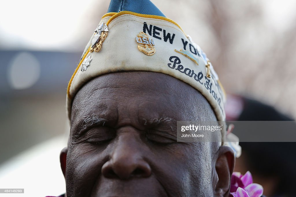 Pearl Harbor survivor Clark Simmons, 92, takes part in a ceremony marking the 72nd anniversary of the attack on Pearl Harbor, Hawaii on December 7, 2013 in New York City. Four Pearl Harbor survivors from the New York area gathered with former crew members of the USS Intrepid to mark the Japanese surprise attack on December 7, 1941 which killed 2,402 Americans and brought the United States into WWII.