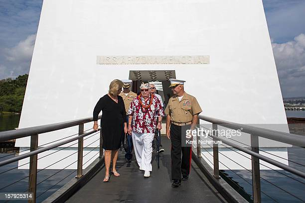 Pearl Harbor survivor Jack Hammett exits the USS Arizona Memorial at the 71st Annual Memorial Ceremony commemorating the WWII Attack On Pearl Harbor...