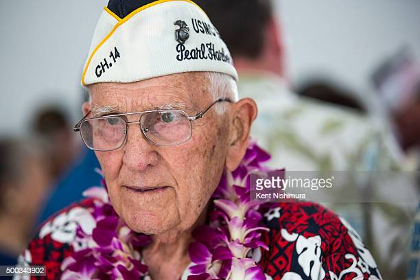 Pearl Harbor Survivor John Hughes looks at the USS Arizona Memorial remembrance wall during a memorial service marking the 74th Anniversary of the...