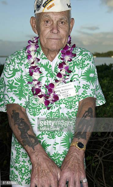 Pearl Harbor survivor Thomas Michenovich shows off his wartime tattoos before the start of a ceremony honoring survivors of the Japanese sneak attack...