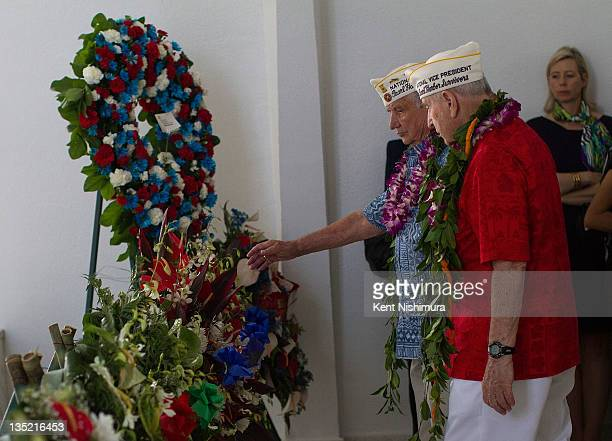 Pearl Harbor Survivors Association President William Muehleib and Vice President Mal Middlesworth present a wreath during a memorial service for the...