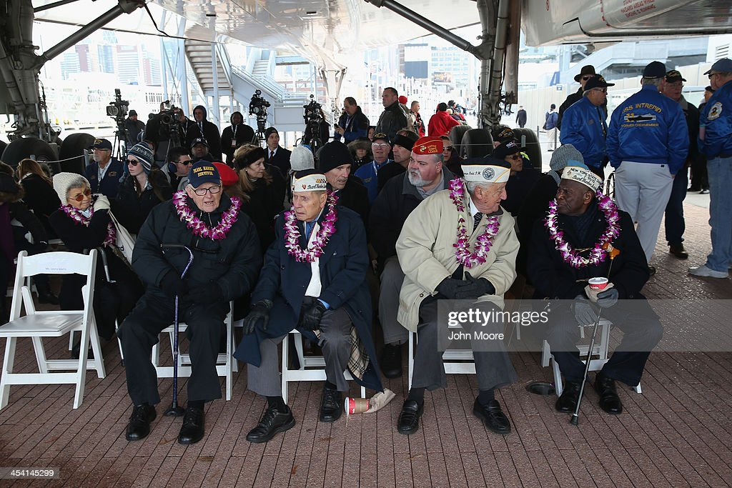 Pearl Harbor survivors attend a ceremony marking the 72nd anniversary of the attack on Pearl Harbor, Hawaii on December 7, 2013 in New York City. Four Pearl Harbor survivors from the New York area gathered with former crew members of the USS Intrepid to mark the Japanese surprise attack on December 7, 1941 which killed 2,402 Americans and brought the United States into WWII.
