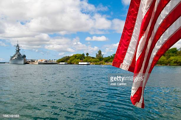 pearl harbor with american flag and u.s.s. missouri - us navy stock pictures, royalty-free photos & images