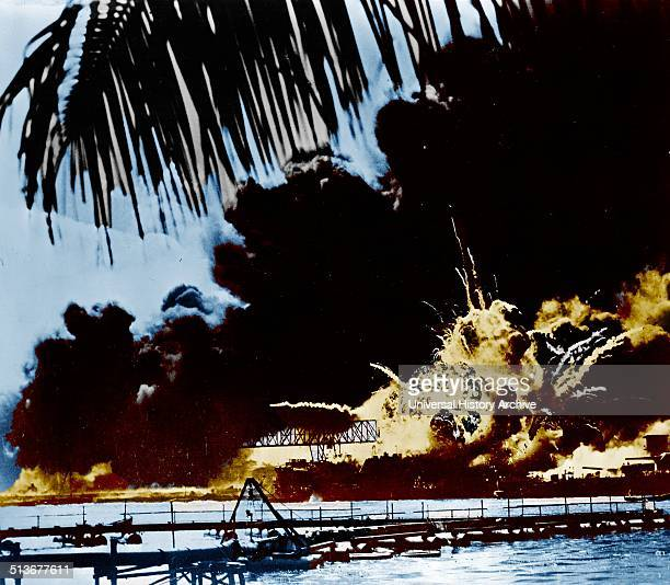 Pearl Harbour naval base and USS Shaw ablaze after the Japanese attack