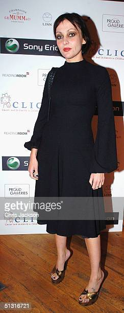 Pearl Lowe attends the preview of the '14 Days' exhibition of live reportage photographs taken by 14 celebrities including Helena Christensen The...