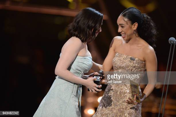 Pearl Mackie presents Laura Donnelly with the award for Best Actress for 'The Ferryman' on stage during The Olivier Awards with Mastercard at Royal...