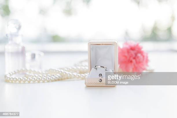pearl necklace and ring - engagement ring box stock photos and pictures