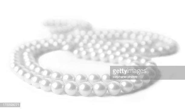Pearl Necklace Lying on a White Background