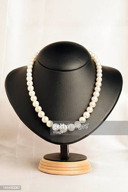 A pearl necklace on display