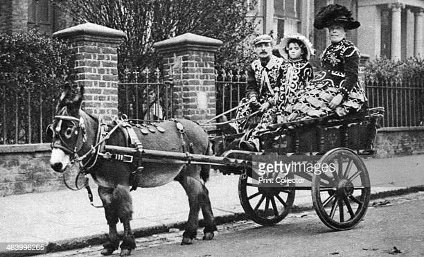 Pearly family in their donkeydrawn 'moke' London 19261927 Cockney 'Pearly kings' wore suits covered in motherofpearl buttons Illustration from...