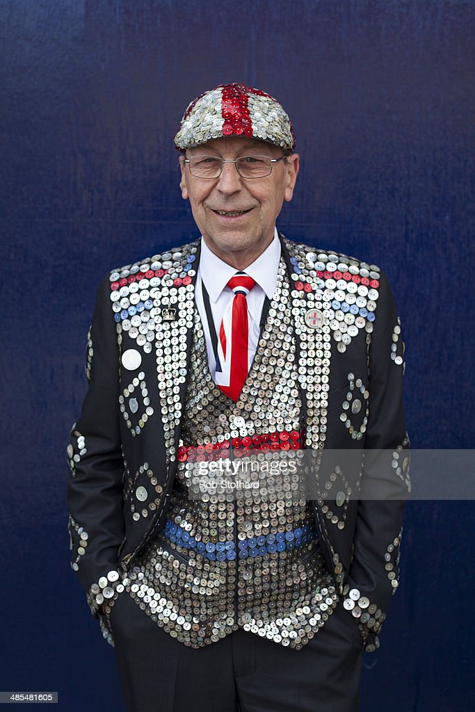 Pearly King Bob Paice poses for a portrait outside the Widow's Son pub in Bromley-by-Bow on April 18, 2014 in London, England. The Widow's Son was built in 1848 upon the former site of an old widow's cottage who, when her only son left to be a sailor, promised to bake him a Hot Cross Bun and keep it for his return. The son never returned but the widow refused to give up hope, baking a fresh one each year. This annual tradition has been continued in the pub as a remembrance of the widow and her son, and of the bond between all those on land and sea, with sailors of the Royal Navy coming to place the bun in a net above the bar.
