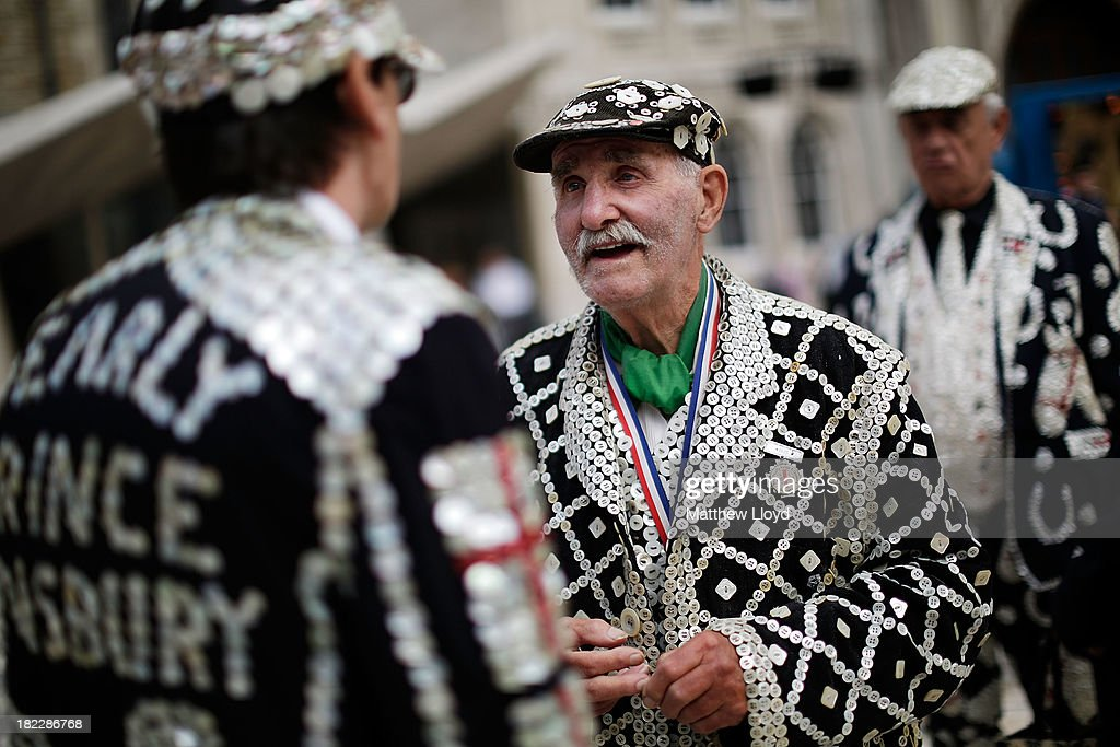 Pearly Kings and Queens gather in the Guildhall Yard on September 29, 2013 in London, England. The Harvest Festival features dancing and entertainment by participants in traditional costumes and concludes with a service at St Mary-le-Bow Church, home of the renowned Bow Bells. Dressing as a Pearly King or Queen, by wearing clothes adorned with pearl buttons, originated in the 19th century when London street sweeper Henry Croft decorated his uniform and began collecting money for charity
