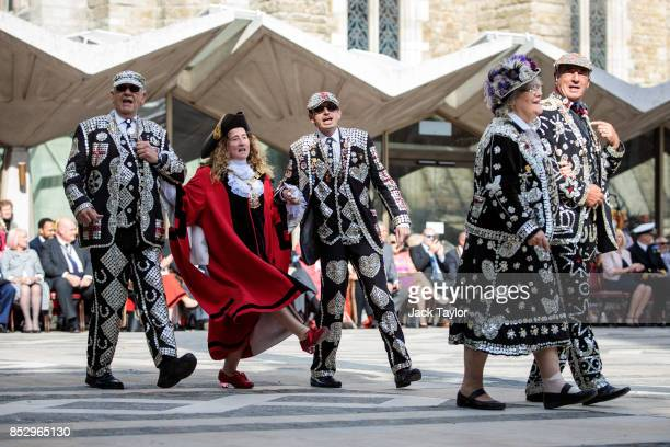 Pearly Kings and Queens sing and parade with Lord Mayors in Guildhall Yard during Harvest Festival on September 24 2017 in London England The...