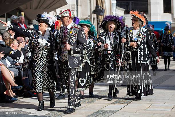 Pearly Kings Queens Princes and Princesses sing as they parade at Guildhall Yard during Harvest Festival on September 25 2016 in London England The...