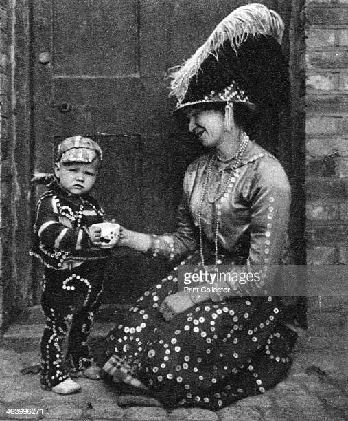 Pearly Queen and Pearly Prince London 19261927 Cockney 'Pearly kings' wore suits covered in motherofpearl buttons Illustration from Wonderful London...