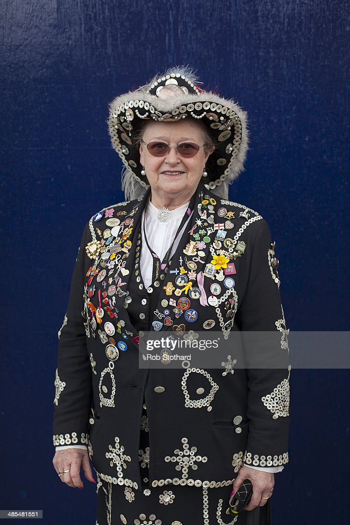 Pearly Queen Christine Prosser poses for a portrait outside the Widow's Son pub in Bromley-by-Bow on April 18, 2014 in London, England. The Widow's Son was built in 1848 upon the former site of an old widow's cottage who, when her only son left to be a sailor, promised to bake him a Hot Cross Bun and keep it for his return. The son never returned but the widow refused to give up hope, baking a fresh one each year. This annual tradition has been continued in the pub as a remembrance of the widow and her son, and of the bond between all those on land and sea, with sailors of the Royal Navy coming to place the bun in a net above the bar.