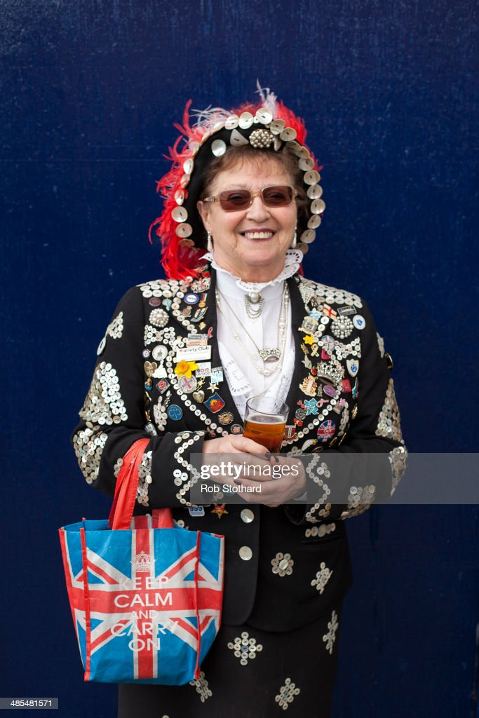 Pearly Queen Doreen Golding poses for a portrait outside the Widow's Son pub in Bromley-by-Bow on April 18, 2014 in London, England. The Widow's Son was built in 1848 upon the former site of an old widow's cottage who, when her only son left to be a sailor, promised to bake him a Hot Cross Bun and keep it for his return. The son never returned but the widow refused to give up hope, baking a fresh one each year. This annual tradition has been continued in the pub as a remembrance of the widow and her son, and of the bond between all those on land and sea, with sailors of the Royal Navy coming to place the bun in a net above the bar.