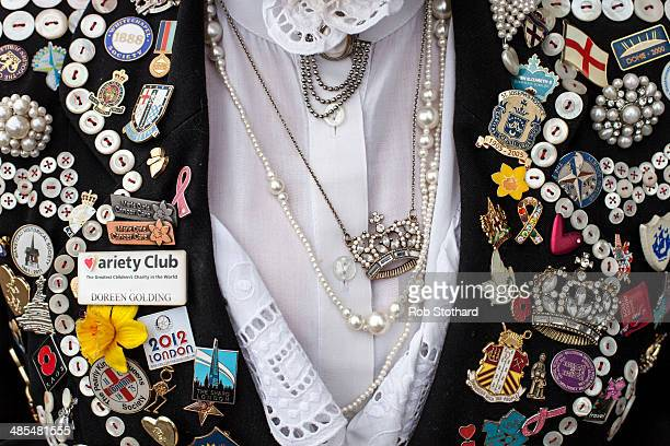 Pearly Queen Doreen Golding shows her outfit outside the Widow's Son pub in BromleybyBow on April 18 2014 in London England The Widow's Son was built...
