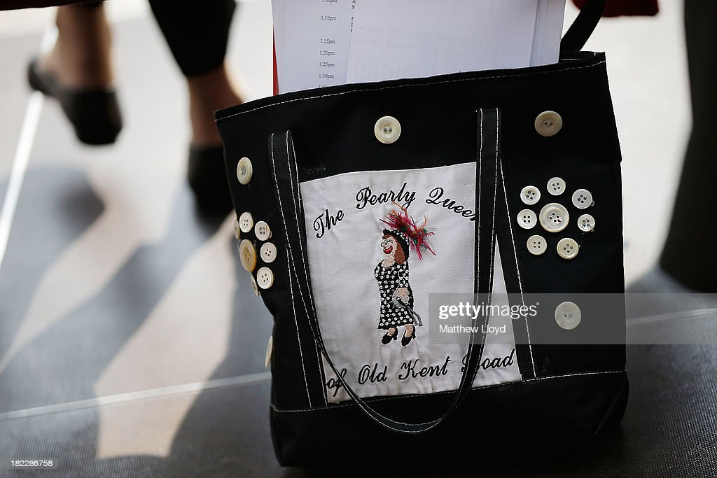 A Pearly Queen's handbag on the floor in Guildhall Yard on September 29, 2013 in London, England. The Harvest Festival features dancing and entertainment by participants in traditional costumes and concludes with a service at St Mary-le-Bow Church, home of the renowned Bow Bells. Dressing as a Pearly King or Queen, by wearing clothes adorned with pearl buttons, originated in the 19th century when London street sweeper Henry Croft decorated his uniform and began collecting money for charity