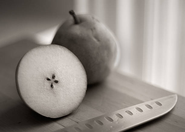 Pears and knife on cutting board